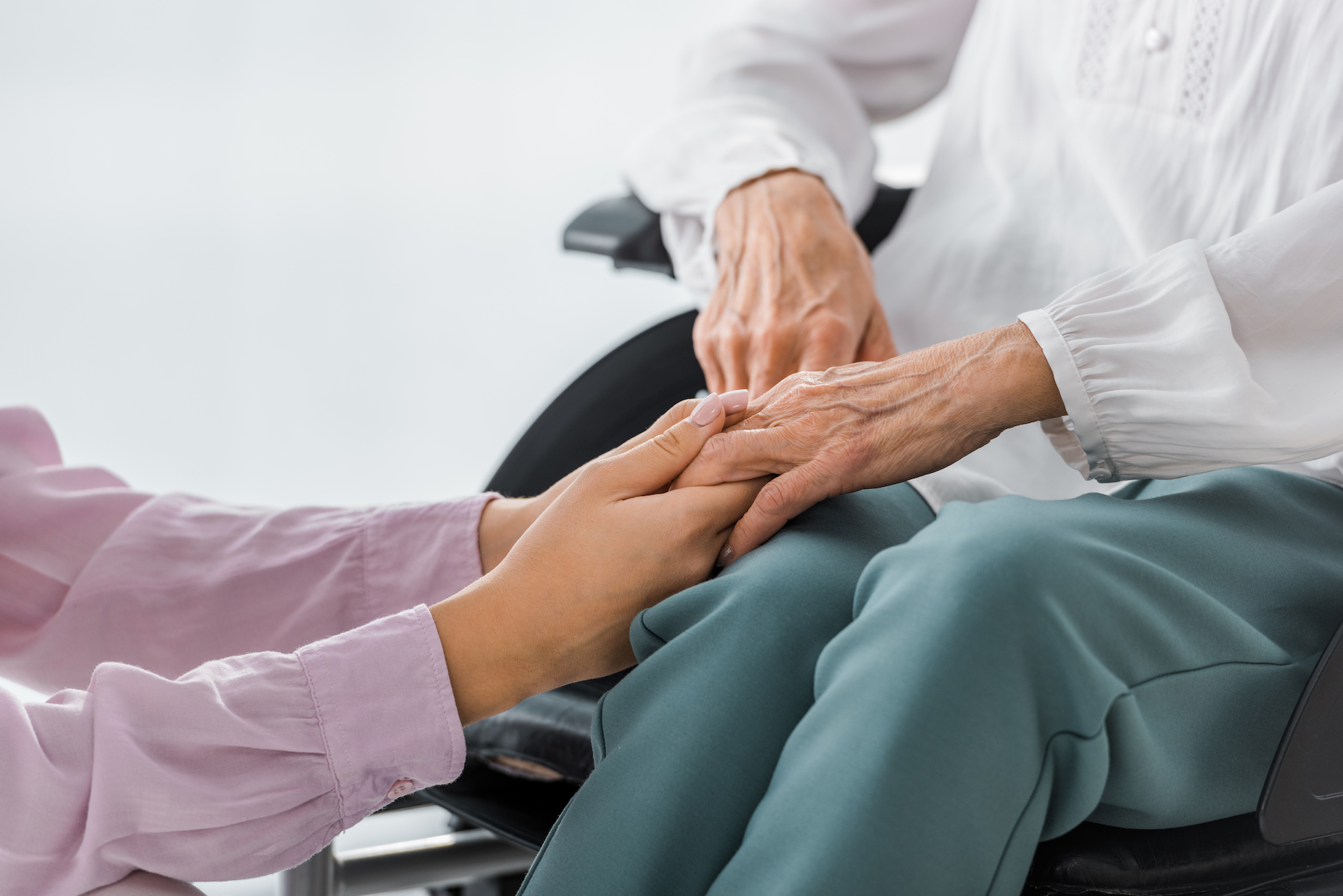 senior women holding hands - Personal Injury Attorney in Nashville - Wrongful Death Attorney, Truck Accident Lawyer, Car Accident Lawyer, and more | Meyers Injury Law